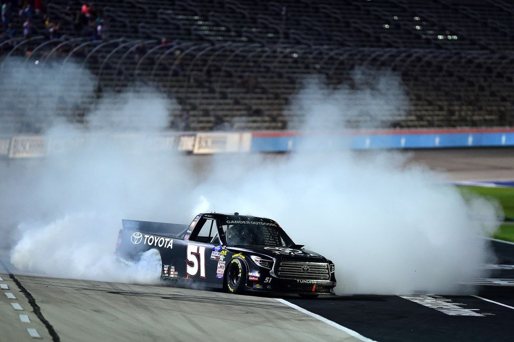 FORT WORTH, TEXAS - JUNE 07: Greg Biffle, driver of the #51 Toyota Toyota, celebrates with a burnout after winning the NASCAR Gander Outdoors Truck Series SpeedyCash.com 400 at Texas Motor Speedway on June 07, 2019 in Fort Worth, Texas. (Photo by Jared C. Tilton/Getty Images)