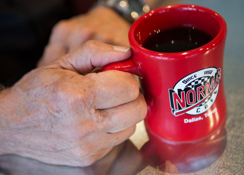 Owner Ed Murph clutches a cup of coffee at Norma's Cafe.