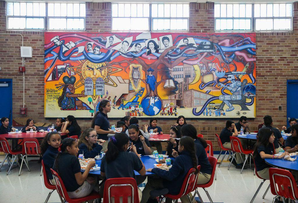 Students eat lunch in the cafeteria of La Fe Preparatory School in El Paso.