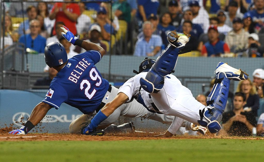 LOS ANGELES, CA - JUNE 13:  Adrian Beltre #29 of the Texas Rangers beats the tag by Austin Barnes #15 of the Los Angeles Dodgers to score a run on a single by Jurickson Profar #19 of the Texas Rangers in the fourth inning of the game at Dodger Stadium on June 13, 2018 in Los Angeles, California.  (Photo by Jayne Kamin-Oncea/Getty Images)