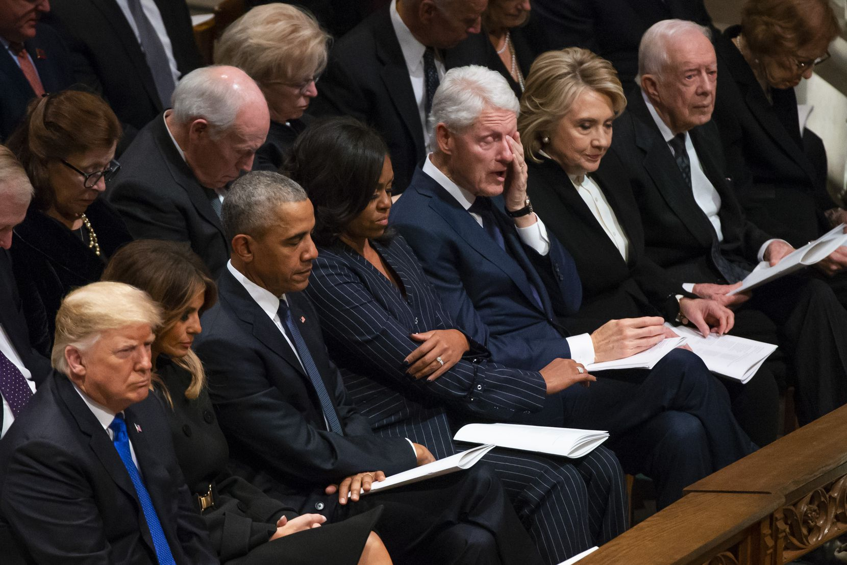 Former President Bill Clinton wipes away tears as Rev. Russel Levenson of St. Martin's Episcopal Church in Houston speaks during the State Funeral for George H.W. Bush, the 41st President of the United States, at the Washington National Cathedral on Wednesday, Dec. 5, 2018, in Washington. From left are President Donald Trump, first lady Melania Trump, former President Barack Obama, Michelle Obama, former President Bill Clinton, former Secretary of State Hillary Clinton, former President Jimmy Carter, and Rosalynn Carter. (Smiley N. Pool/The Dallas Morning News)