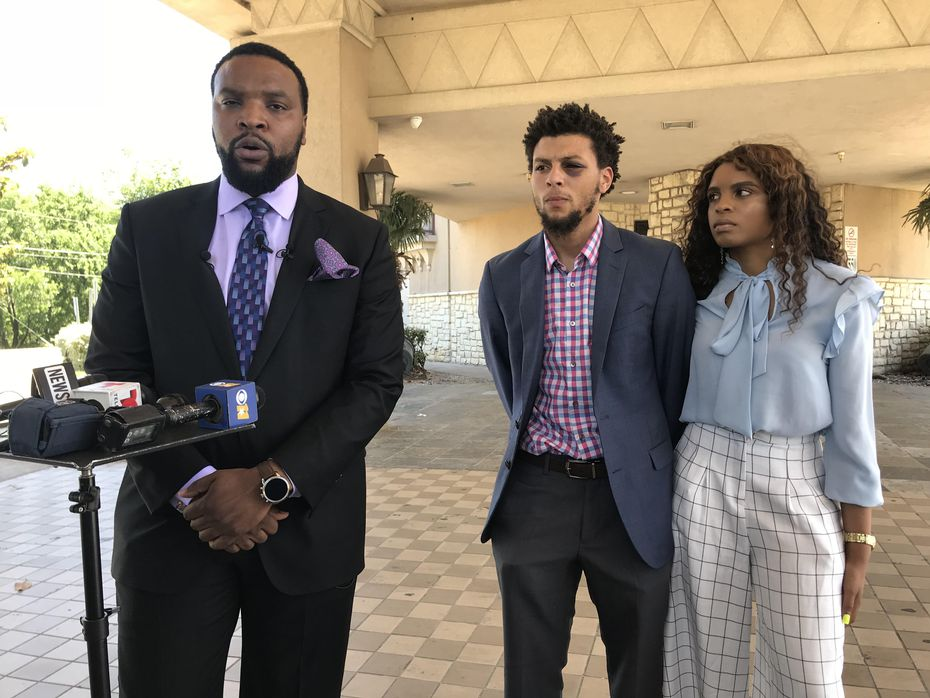 From left: Attorney Lee Merritt, Jalen Bell and Logan Bell hold a news conference Wednesday outside XTC Cabaret in Dallas.