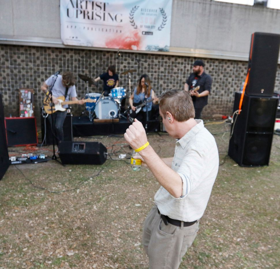 Tom Bannon dances to the music of Sealion, one of the bands that performed at the Artist Uprising Presents: The Dallas MusicExperience at Harry C. Beck Jr. Park on Friday April 7, 2017. (Ron Baselice/The Dallas Morning News)