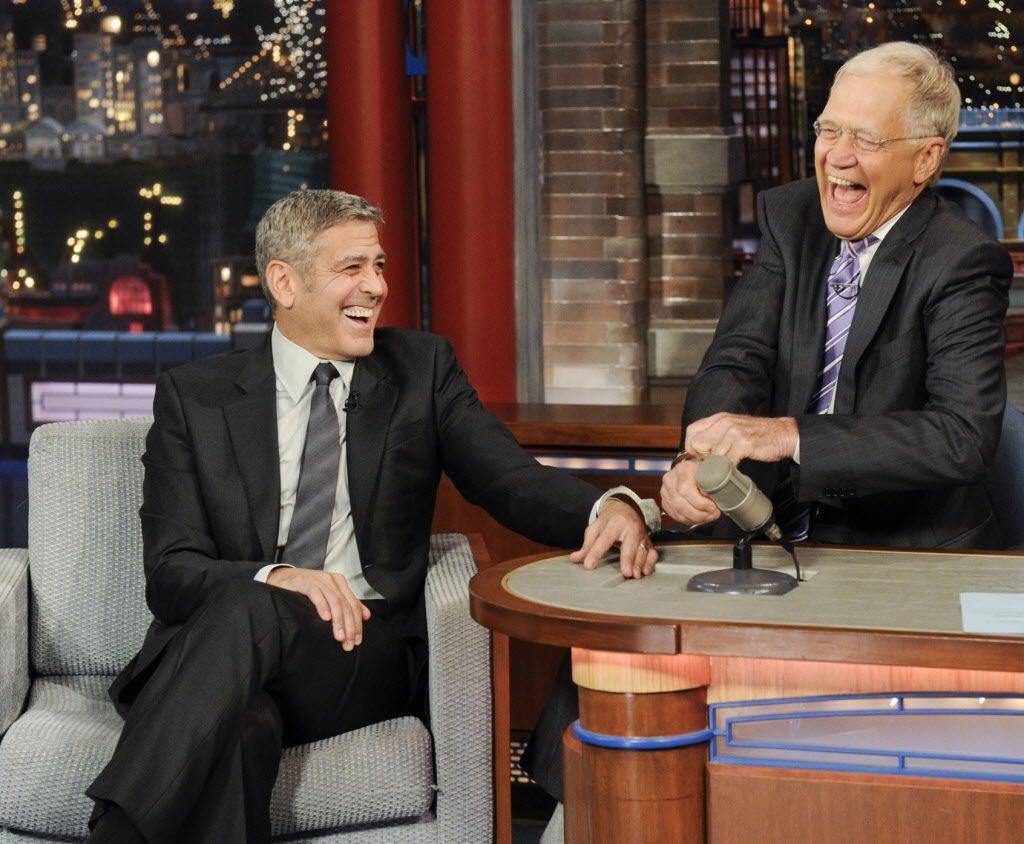 """George Clooney handcuffs himself to host David Letterman on the set of the """"Late Show."""