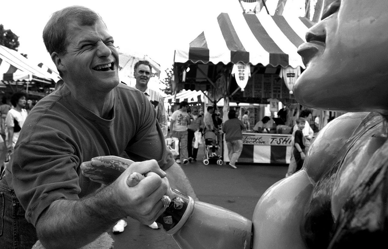 Keith Joeris of  Sachse tries his luck at beating Mr. Muscle at the State Fair of Texas in 1993. For a quarter anyone can try their luck at beating Mr. Muscle, in eight different weight classes. Keith tied Mr. Muscle in his weight class.