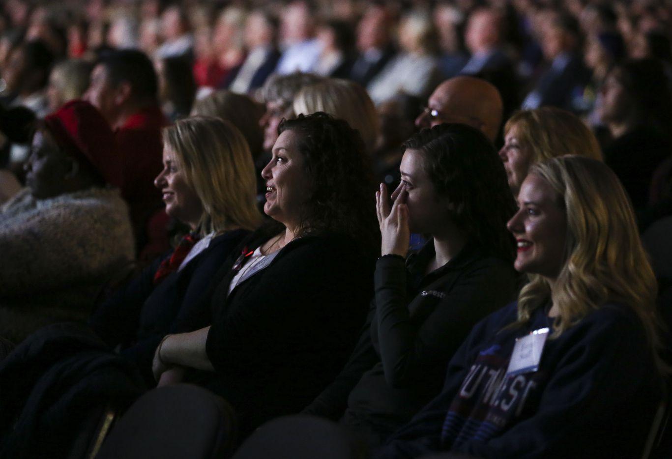 Audience members react as Colleen Barrett tells stories.