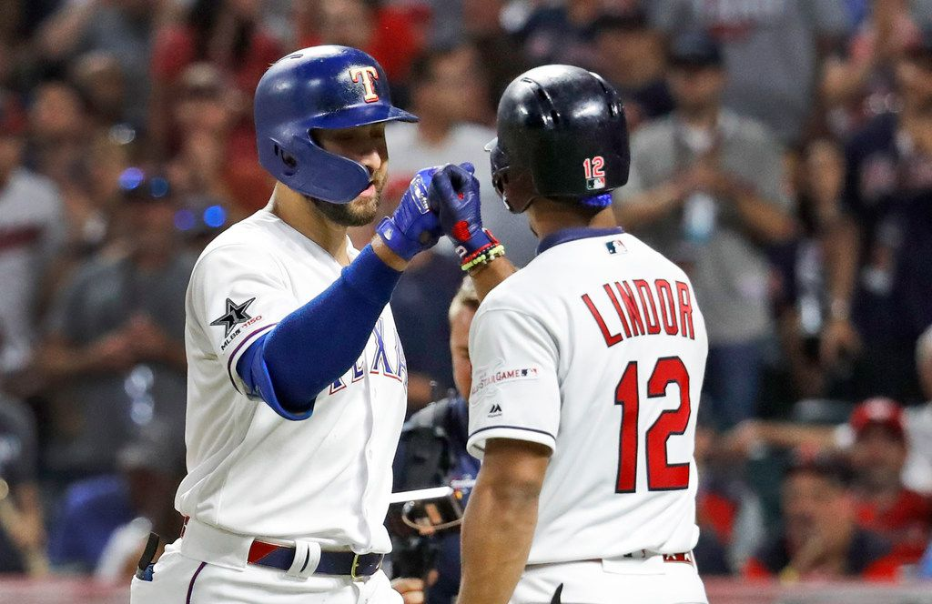American League's Joey Gallo, left, of the Texas Rangers, is congratulated by American League teammate Francisco Lindor, of the Cleveland Indians, after Gallo hit a solo home run during the seventh inning of the MLB baseball All-Star Game, Tuesday, July 9, 2019, in Cleveland. (AP Photo/John Minchillo)
