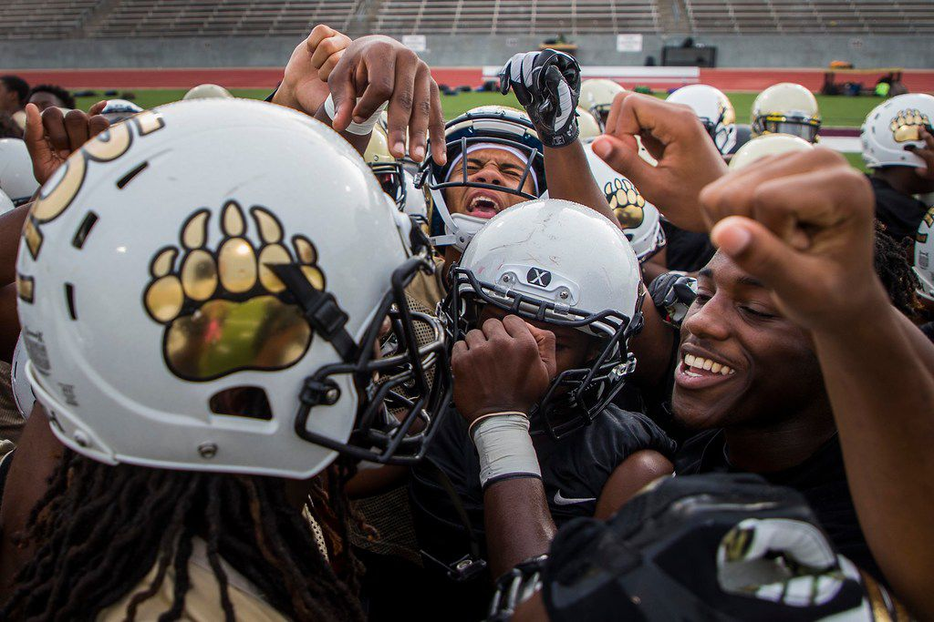 South Oak Cliff players huddle at the start of their season-opening football practice at John Kincaide Stadium on Monday, Aug. 13, 2018, in Dallas. (Smiley N. Pool/The Dallas Morning News)