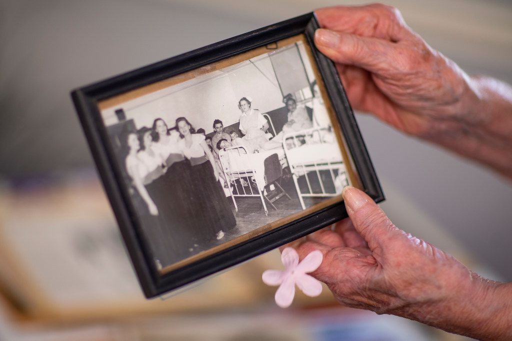 Hilda Tinker Rautenberg goes through a picture of her United Service Organizations trip at Mustang Creek Estates in Keller.
