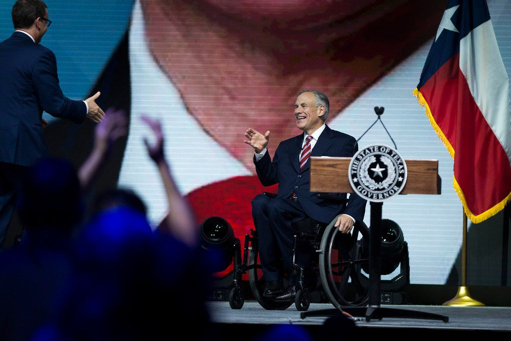 Texas Gov. Greg Abbott takes the stage to address the NRA-ILA Leadership Forum at the Kay Bailey Hutchison Convention Center.