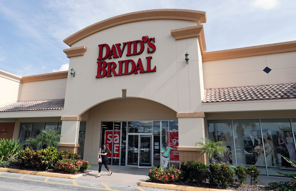 The entrance to a David's Bridal store is seen Monday, Nov. 19, 2018, in Orlando, Fla. David's Bridal is filing for bankruptcy protection but there is no danger for customers who have ordered dresses because operations are continuing as normal while the wedding and prom retailer restructures.