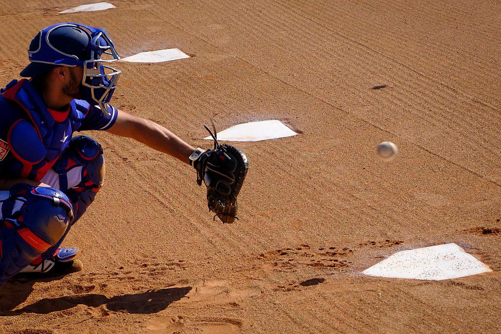 Texas Rangers catcher Isiah Kiner-Falefa catches a bullpen session during a spring training workout at the team's training facility on Sunday, Feb. 17, 2019, in Surprise, Ariz.. (Smiley N. Pool/The Dallas Morning News)