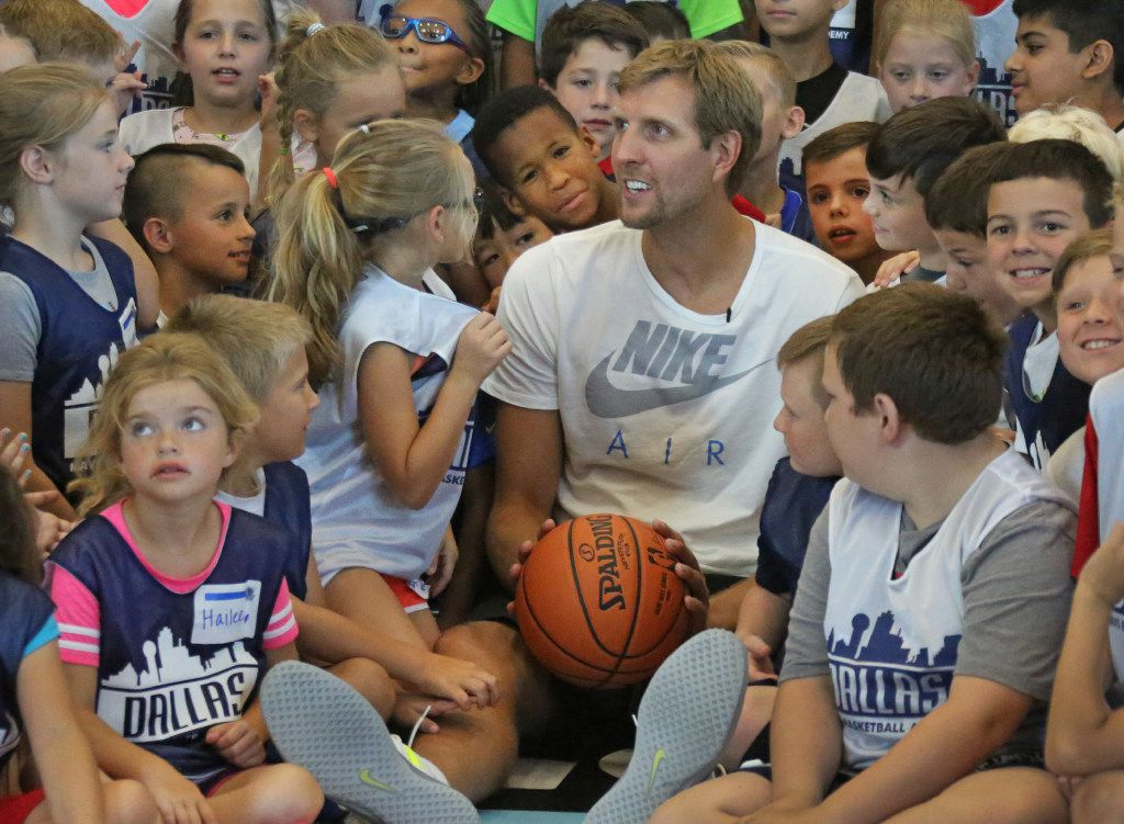 Dirk Nowitzki chatted with, entertained and shot baskets with kids attending the Mavs Basketball Academy Summer Hoop Camp in Allen on Tuesday. (Louis DeLuca/The Dallas Morning News)