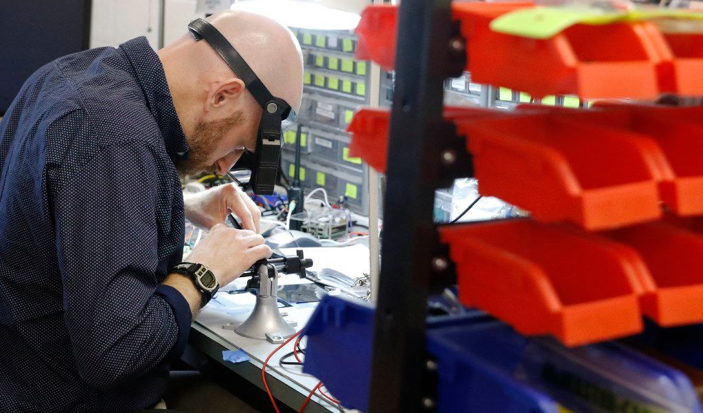 Jesse Hamner, chief engineer & co-founder of Kubos, places a GPS chip on a printed circuit board at Kubos in Denton, Texas on April 17, 2017. Kubos is a satellite software platform startup providing small satellite companies with services. (David Woo/The Dallas Morning News)