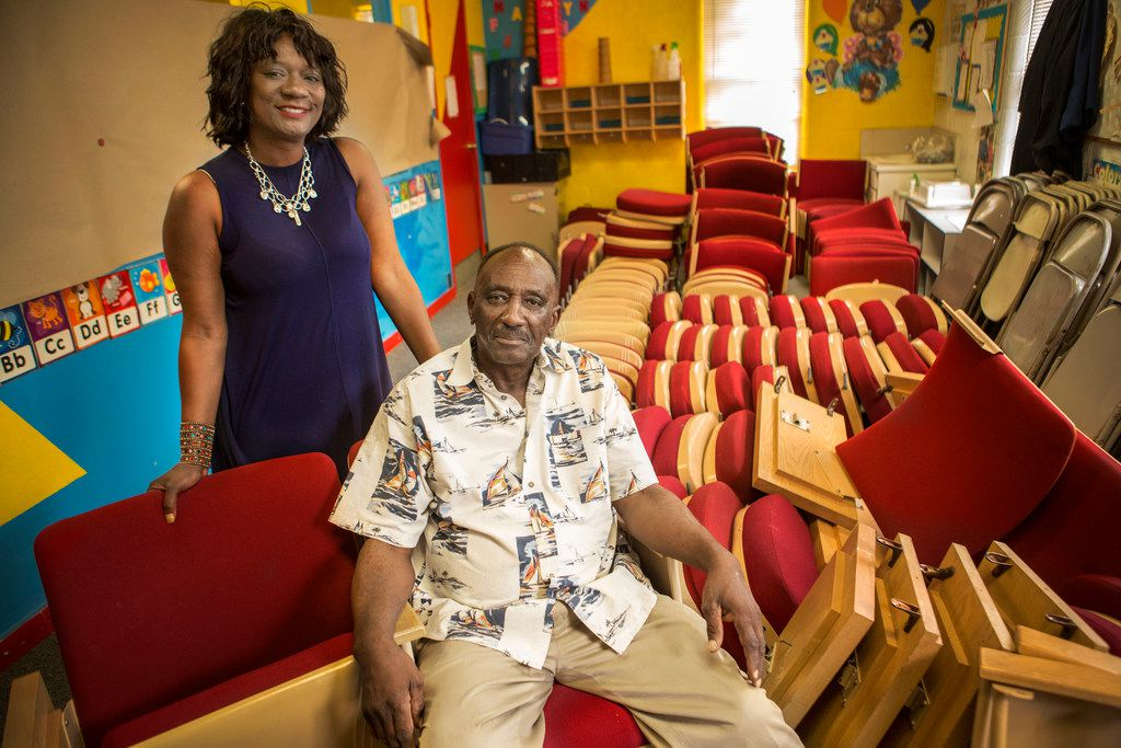 Assata Thomas, left, poses for a photograph with her father George Gregory, pastor and founder at First Fellowship Baptist Church in Dallas on July 27, 2018. (Carly Geraci/The Dallas Morning News)