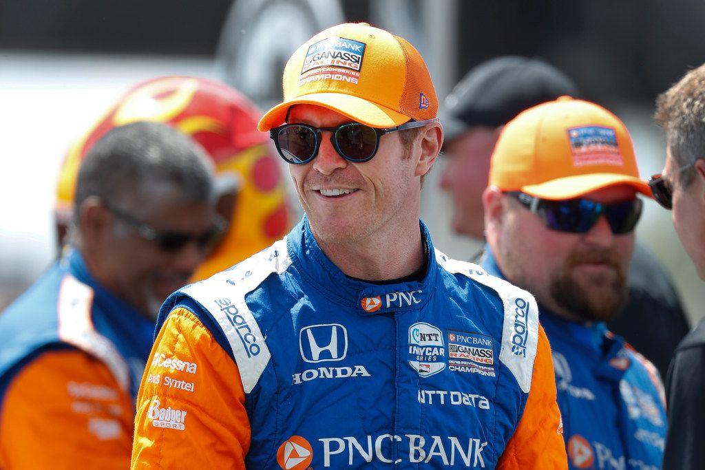 Scott Dixon smiles before the second race of the IndyCar Detroit Grand Prix auto racing doubleheader in Detroit, Sunday, June 2, 2019. (AP Photo/Paul Sancya)