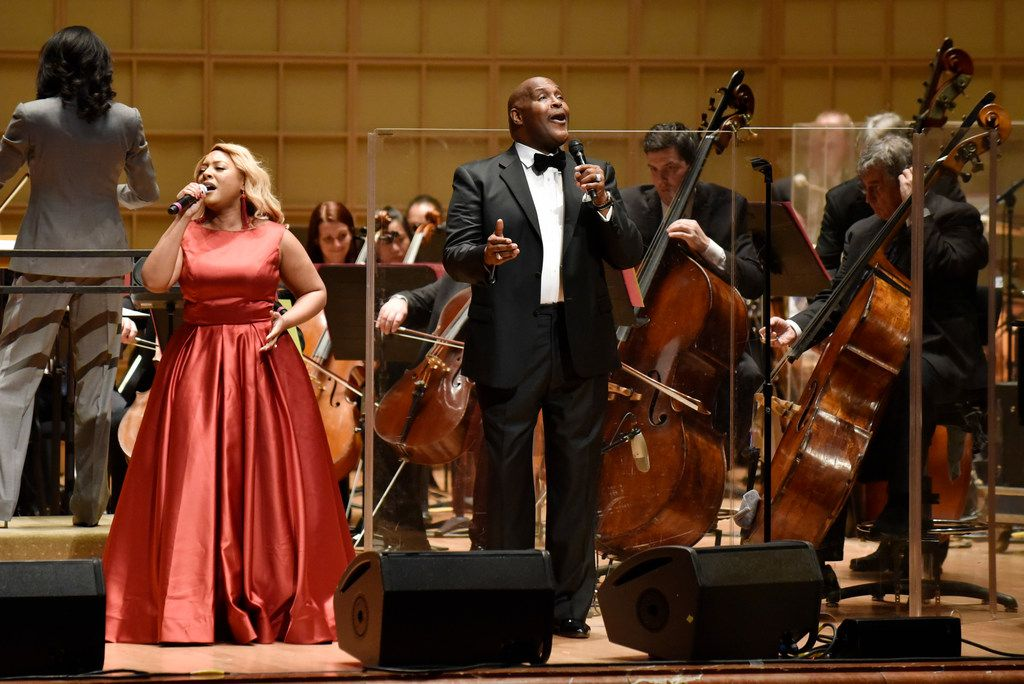 Singer DeShonda Rideout and Marvin Winans sing with the Dallas Symphony Orchestra during a performance of Gospel Goes Classical on Feb. 7, 2019 at the Morton H. Meyerson Symphony Center in Dallas.