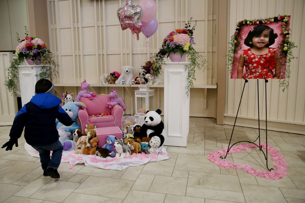 Aaron Gross, 3, runs up to a memorial for 3-year-old Sherin Mathews after an interfaith service at Restland Memorial Chapel and Restland Memorial Park in Dallas.