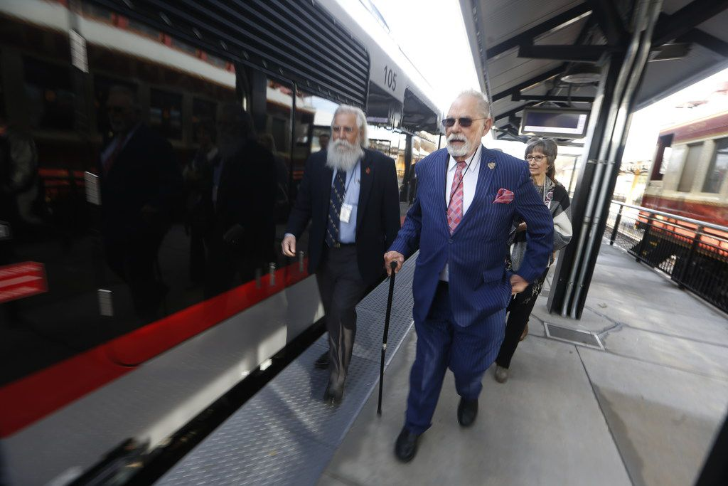 Grapevine Mayor William D. Tate (right) walks with Paul McCallum, executive director of the Grapevine Convention and Visitors Bureau, before boarding the Trinity Metro TEXRail train Monday in Grapevine for its maiden trip from the Grapevine/Main Street Station to DFW Airport.