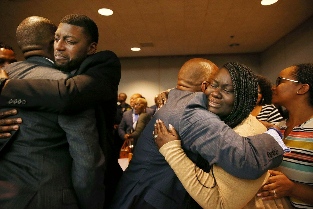 Odell Edwards and Charmaine Edwards, parents of Jordan Edwards, embrace supporters after a guilty verdict in the trial of former Balch Springs police officer Roy Oliver.
