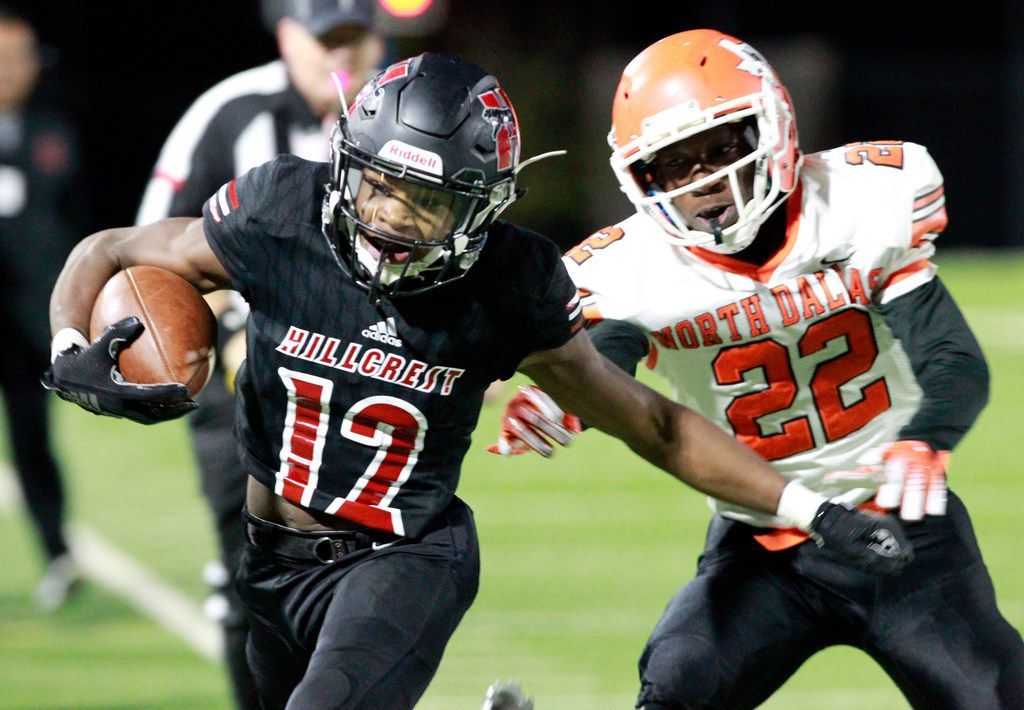 Hillcrest's Zion Cornelius (12) is pushed out of bounds by North Dallas' Trevion Smith (22), after picking up a first down during the first half of their high school football game at Franklin Stadium in Dallas on Friday, October 11, 2019. (John F. Rhodes / Special Contributor)