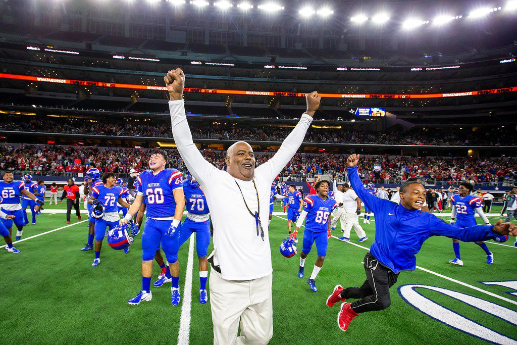 Duncanville coach Reginald Samples leads the celebration after a 44-35 victory over Allen in a Class 6A Division I state semifinal at AT&T Stadium last season. (Smiley N. Pool/The Dallas Morning News)