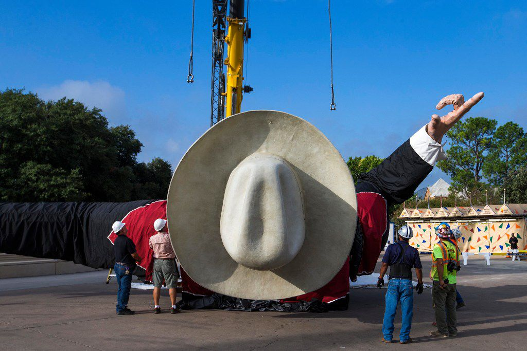 Workers install Big Tex in Fair Park on Friday, Sept. 23, 2016, in Dallas. The State Fair of Texas opens on September 30 and runs through October 23. (Smiley N. Pool/The Dallas Morning News)