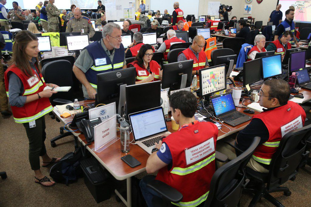 Officials at the State of Texas Emergency Command Center at Department of Public Safety headquarters in Austin, Texas monitor Hurricane Harvey Saturday morning, Aug. 26, 2017.