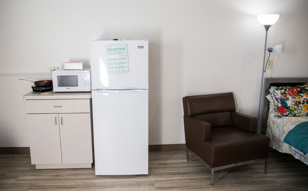 The kitchenette, chair and bed inside a room at St. Jude Center, a senior-living facility for homeless and veterans on Thursday, August 23, 2018. The Dallas Housing Authority was supposed to fill the facility with residents using vouchers, but vouchers are not available due to lack of funding. (Ashley Landis/The Dallas Morning News)