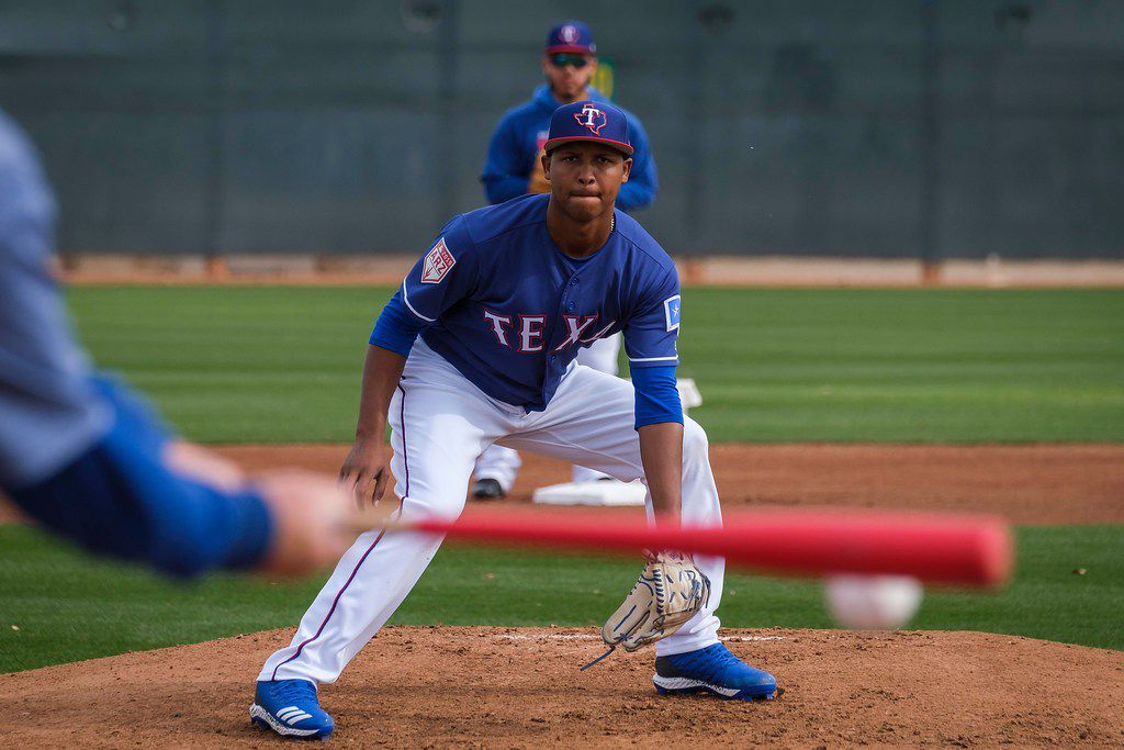 Texas Rangers pitcher Jose Leclerc participates in fielding practice during the first pitchers and catchers spring training workout at the team's training facility on Wednesday, Feb. 13, 2019, in Surprise, Ariz.. (Smiley N. Pool/The Dallas Morning News)