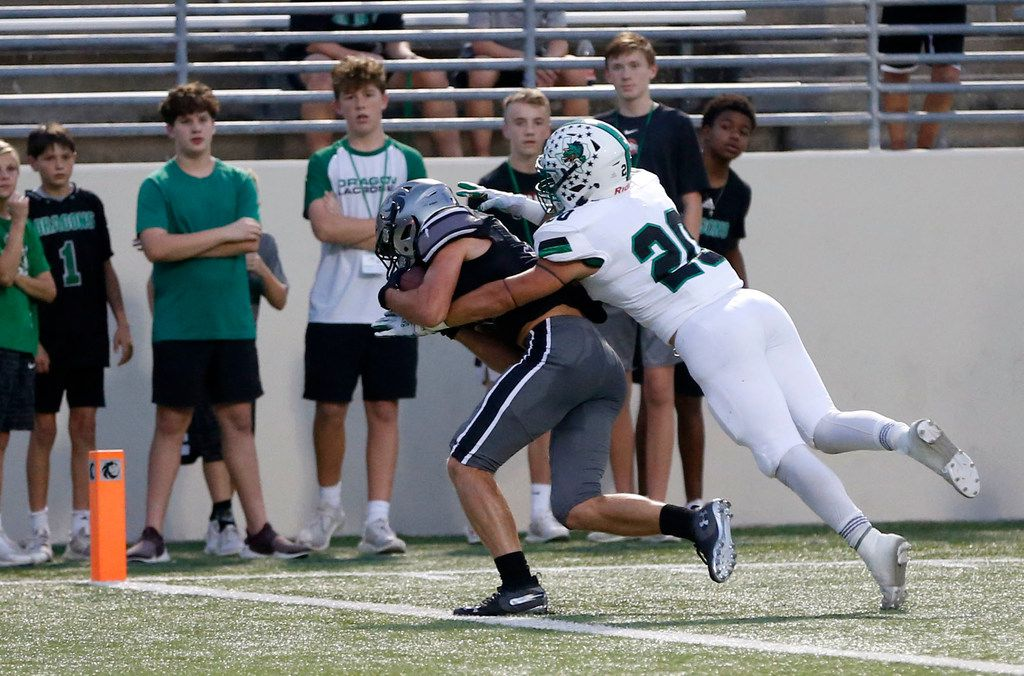 Denton Guyer's Seth Meador (19) catches a pass for a touchdown in front of Southlake Carroll's James Miscoll (20) during the first half of play at C.H. Collins Complex in Denton, on Friday, October 4, 2019. (Vernon Bryant/The Dallas Morning News)