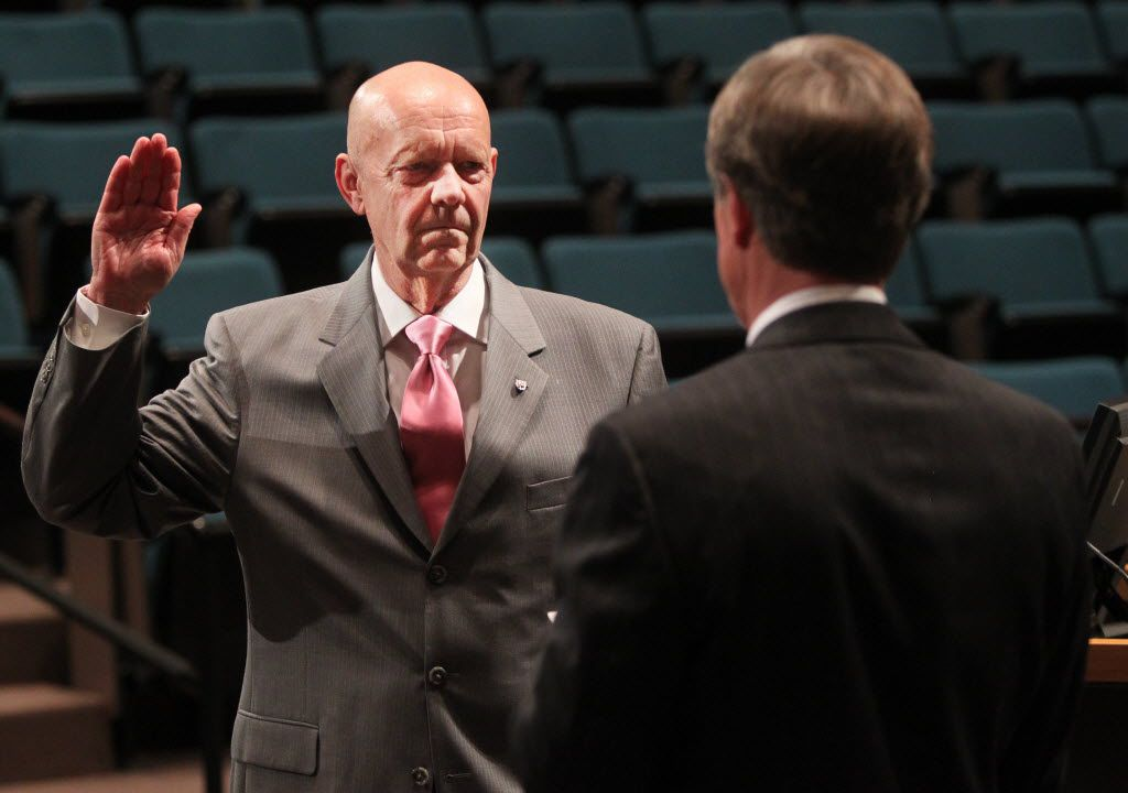 Plano Mayor Phil Dyer (right) helped administer the oath of office after Bruce Glasscock was chosen city manager during a special session of the City Council on Feb. 17, 2011.