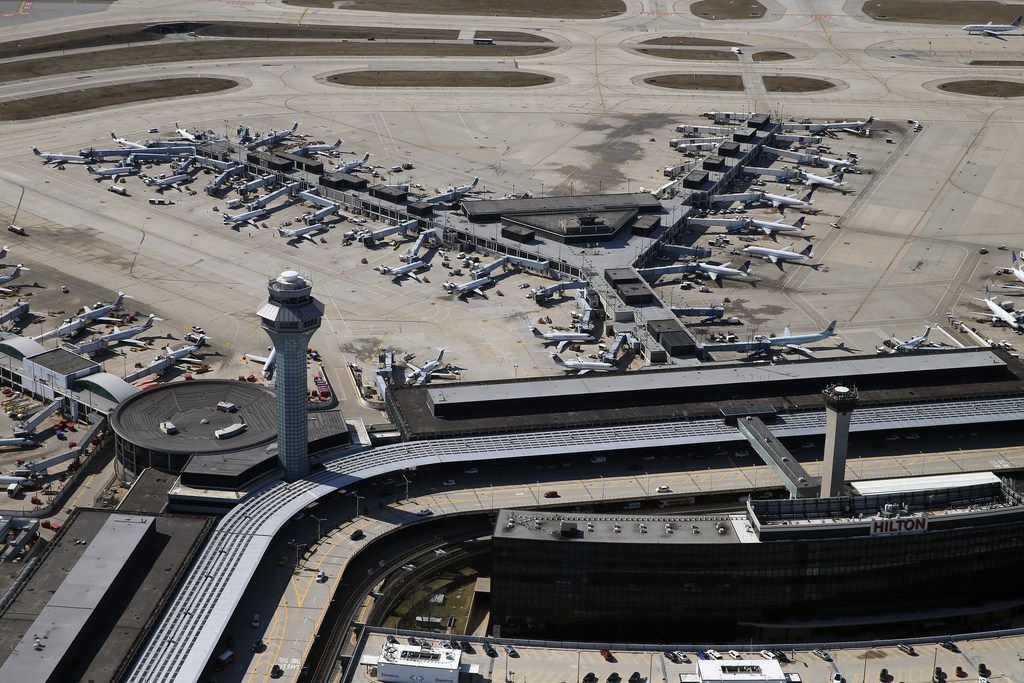 The city's proposed overhaul of O'Hare International Airport calls for replacing the 55-year-old Terminal 2, seen at top, with a new Global Terminal to house United Airlines and American Airlines, alongside their international partners. (Terrence Antonio James/Chicago Tribune/TNS)