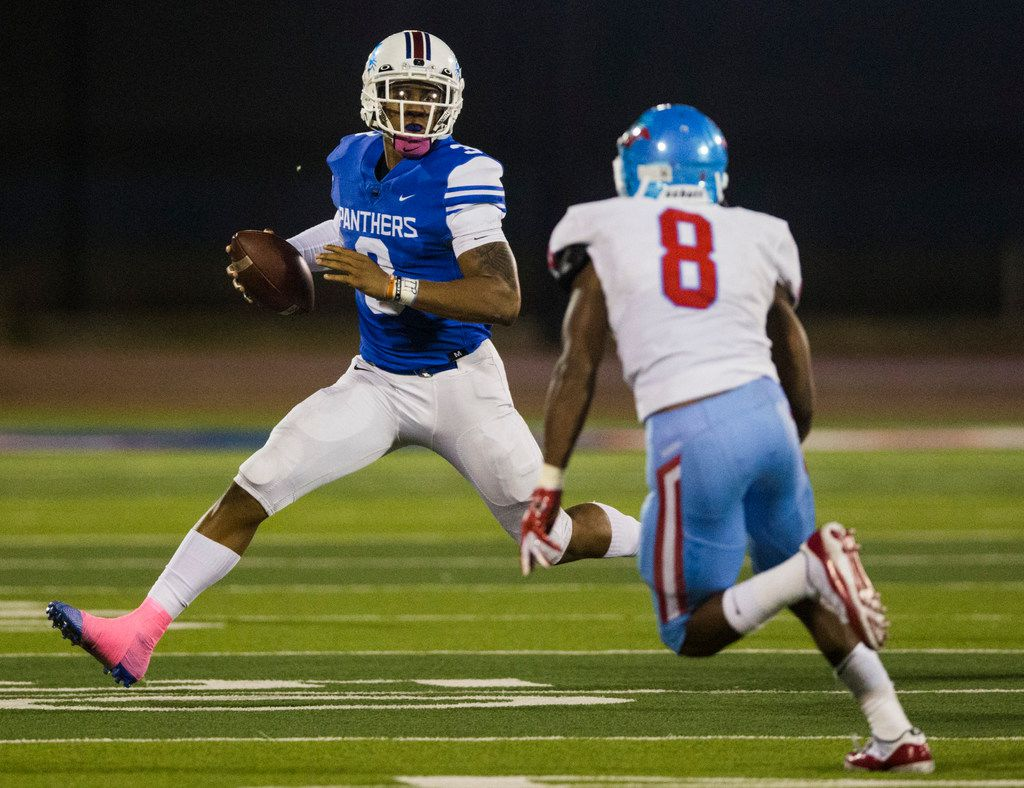 Duncanville quarterback Ja'Quinden (3) runs the ball against Skyline linebacker Javius Williams (8) during the second quarter of a high school football game between Skyline and Duncanville on Friday, October 4, 2019 at Panther Stadium in Duncanville. (Ashley Landis/The Dallas Morning News)