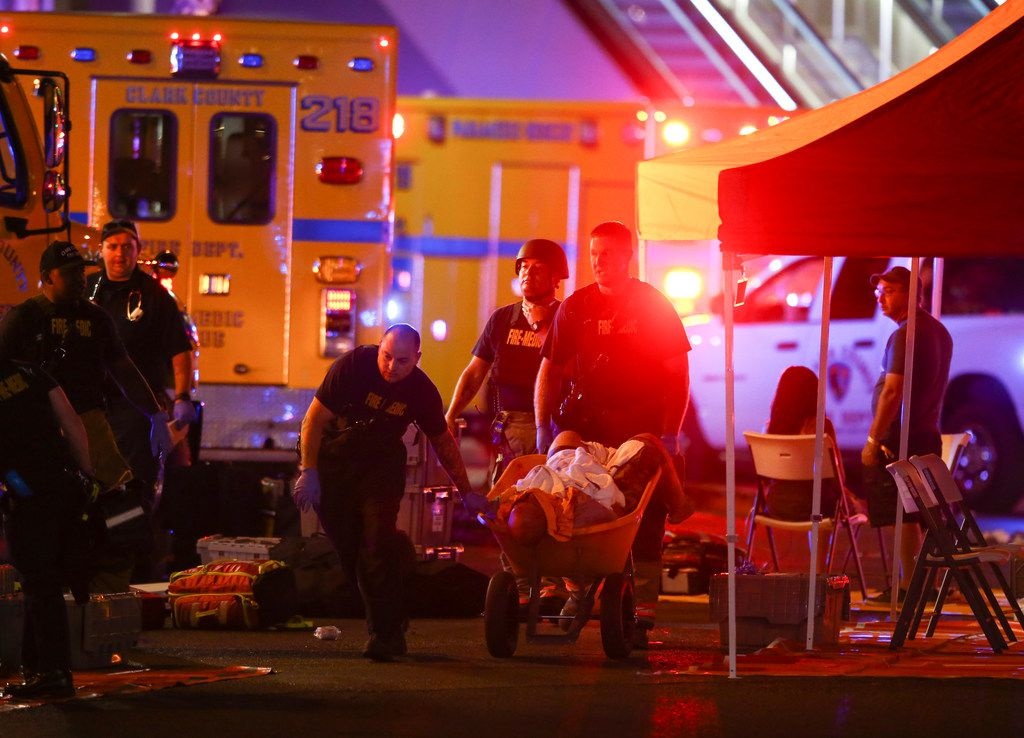 A wounded person is walked in on a wheelbarrow as Las Vegas police respond to a mass shooting along the Strip on Oct. 1.