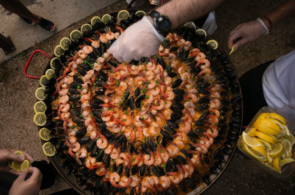 Chef Juan Rodriguez puts the final touches on the seafood paella during the supper club dinner at Magdalena's in Fort Worth.
