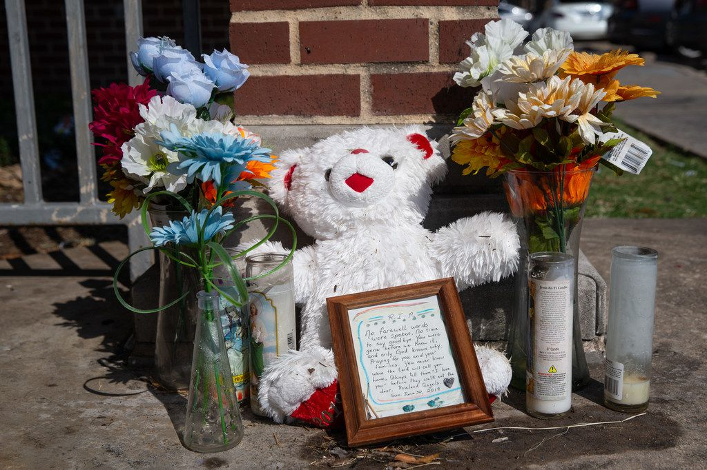 A memorial dedicated to two 17-year-olds killed in June remains at a community center near the Roseland Townhomes in Dallas on Thursday, Aug. 15, 2019. The two victims, Zacchaeus Banks and Gregory Horton III, were killed in a drive-by shooting targeting people playing dice.