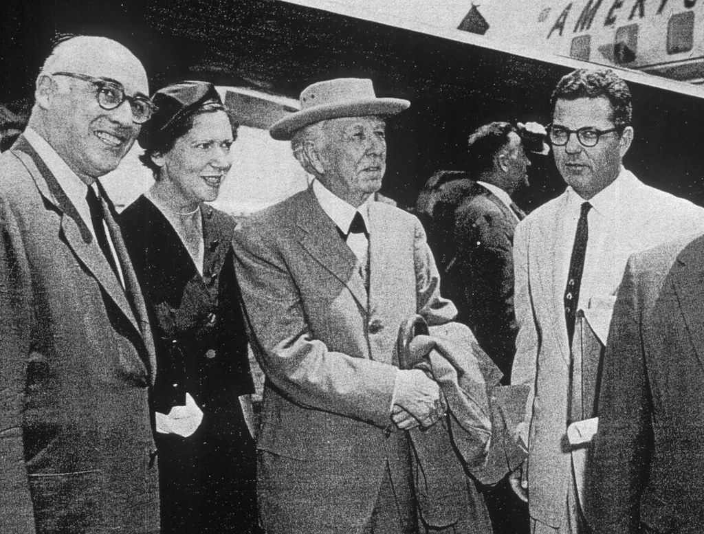 Robert Stecker (left), president Dallas Theater Center Board, with Kalita Humphreys Theater architect Frank Lloyd Wright (center) and Paul Baker, director of the Dallas Theater Center, upon Wright's arrival at Love Field. Undated.
