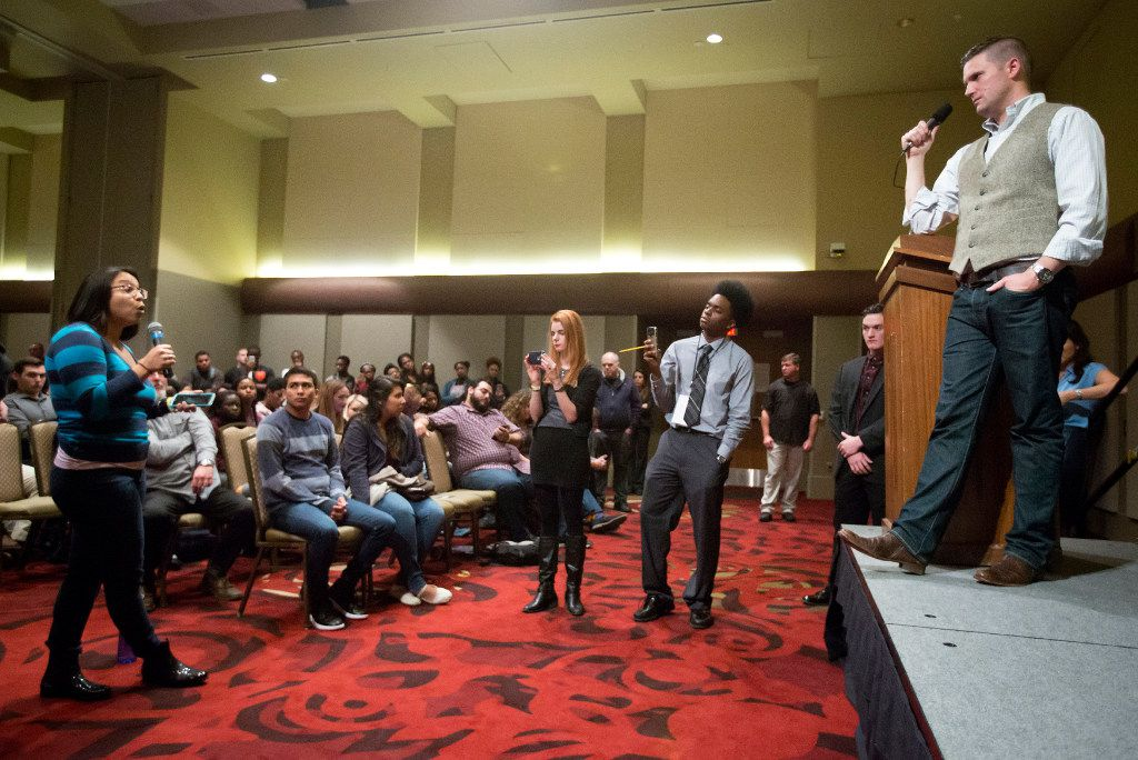 "Richard Spencer takes questions from the audience after speaking at the Memorial Student Center at Texas A&M University on Tuesday, Dec. 6, 2016, in College Station, Texas. Spencer, a Dallas native and a self-professed founder of the ""alt right"" movement, will speak at the campus at the invitation of a white nationalist and former student.  The university hosted the Aggies United event at Kyle Field, the university's football stadium, to overlap with Spencer's speech."