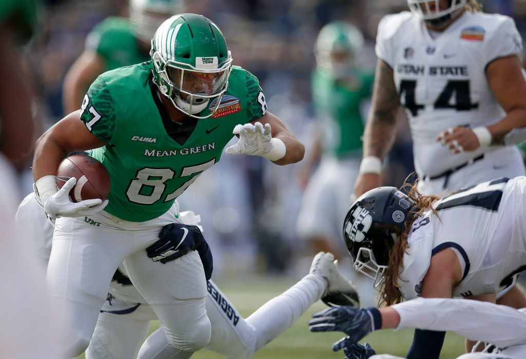 North Texas tight end Kelvin Smith (87) tries to breaks away of the Utah State defense during the first half of the New Mexico Bowl NCAA college football game in Albuquerque, N.M., Saturday, Dec. 15, 2018. (AP Photo/Andres Leighton) ORG XMIT: OTKAL106