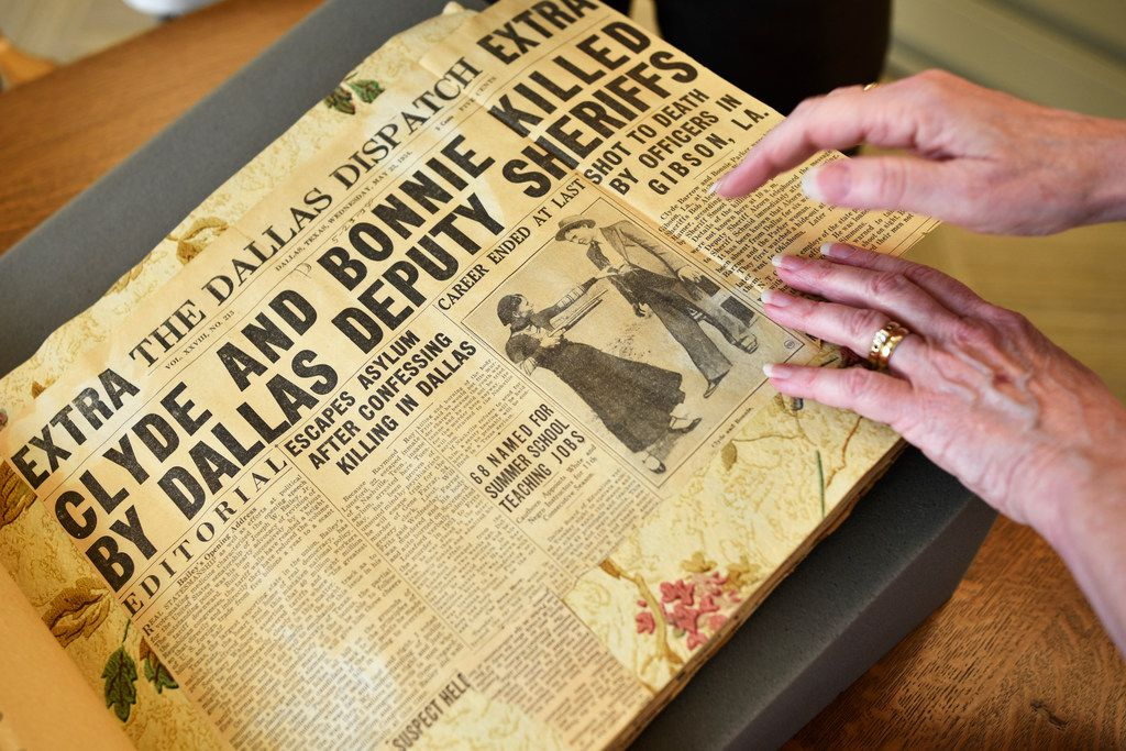 Dallas writer Karen Blumenthal browses a newspaper scrapbook from Sheriff R.A. Smoot Schmid   at the J. Erik Jonsson Central Library in downtown Dallas.
