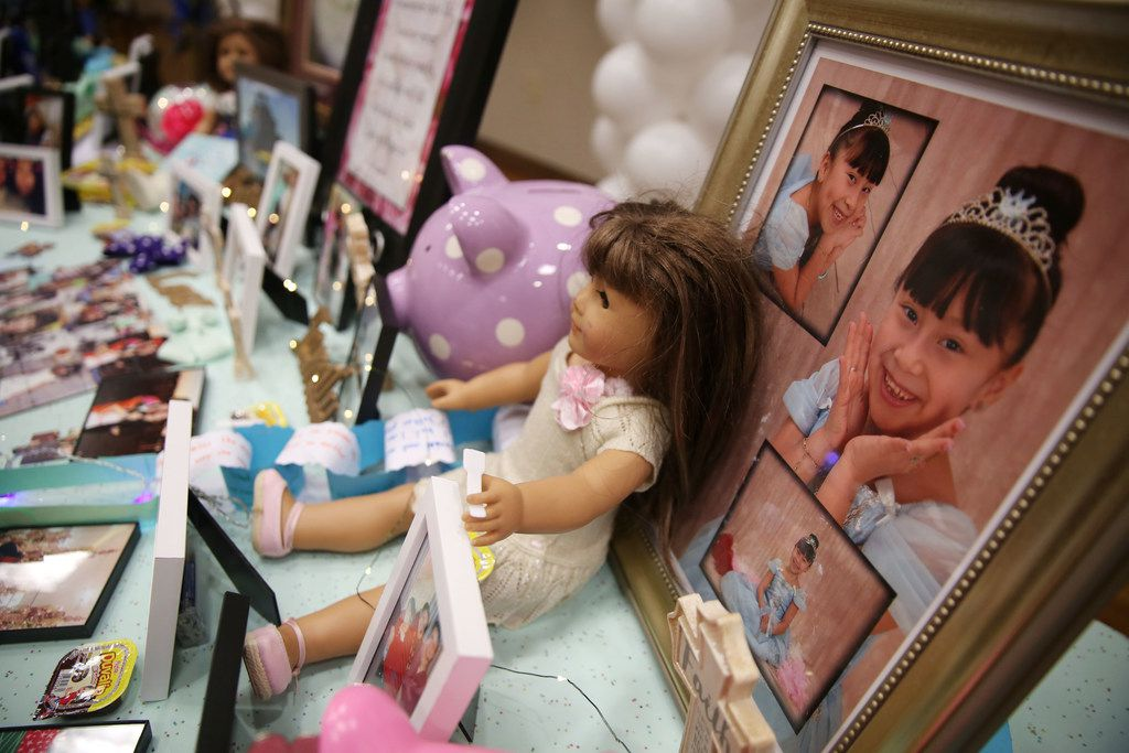 Pictures and mementos line a table at a memorial service and viewing for 12-year-old Linda Rogers at Park Cities Presbyterian Church in Dallas on Thursday.