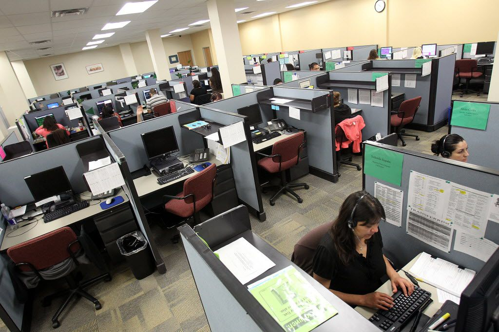 """A technology upgrade was supposed to improve service to parents seeking child-support payments from former spouses -- walk ins at Texas Child Support Division offices around the state, online applicants and toll-free callers to state employees such as these in San Antonio. Lawmakers are about to put the """"T2"""" project on hold, though."""