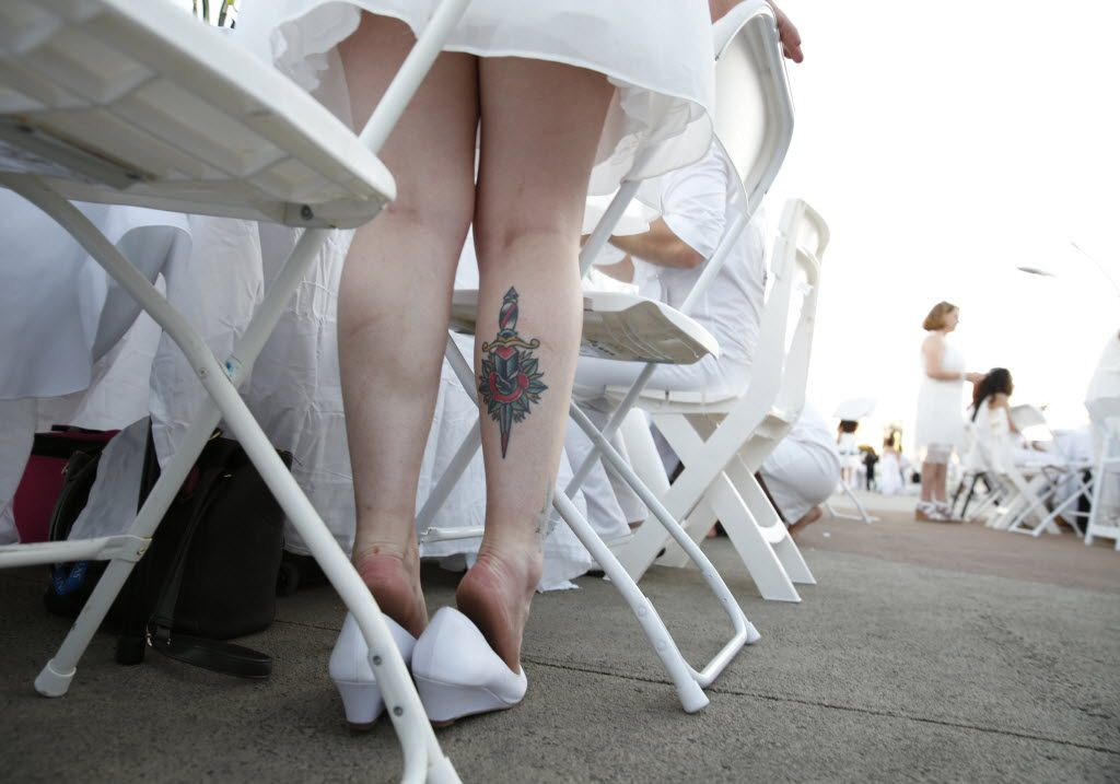 Brittany Caramanna waits by her table during the inaugural Diner en Blanc Dallas on the Continental Avenue Bridge in Dallas on Sept. 17, 2015. Exactly 1,678 people attended the event, which requires dinner guests to dress all in white and bring their own tables, chairs and centerpieces. As per tradition, the location was kept private leading up to the event.