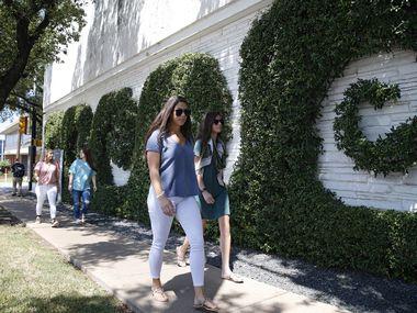 Sara Salvatierra (left) and Simone Henderson walk around the Simpli.fi building in Fort Worth.