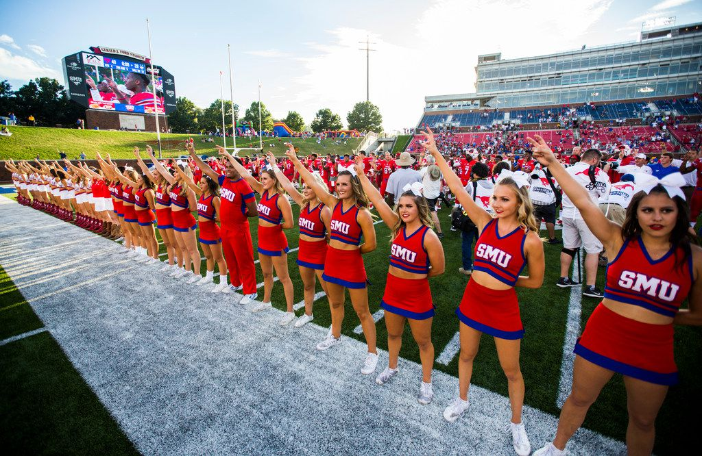 Southern Methodist Mustangs cheerleaders and football players celebrate after a 49-28 win over the Connecticut Huskies on Saturday, September 30, 2017 at SMU's Ford Stadium in Dallas. (Ashley Landis/The Dallas Morning News)
