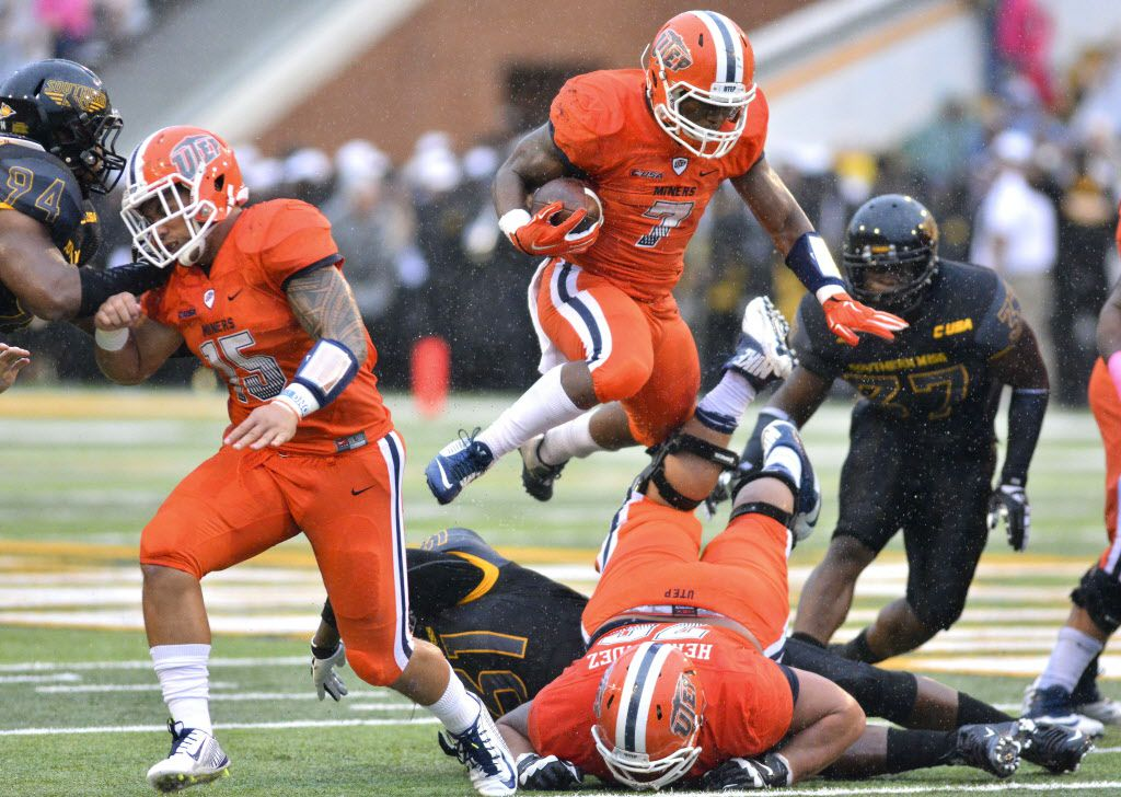 Oct 31, 2015; Hattiesburg, MS, USA; UTEP Miners running back LaQuintus Dowell (7) jumps over the line of scrimmage during the game against the Southern Miss Golden Eagles at M.M. Roberts Stadium. Mandatory Credit: Matt Bush-USA TODAY Sports