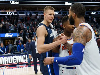 Dallas Mavericks forward Kristaps Porzingis congratulates New York Knicks forward Marcus Morris Sr. after the Knicks victory in an NBA basketball game at American Airlines Center on Friday, Nov. 8, 2019, in Dallas. (Smiley N. Pool/The Dallas Morning News)