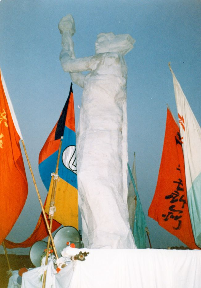 On the night of May 29, 1989, protesters in Tiananmen built their own Statue of Liberty -- they called it the Goddess of Democracy -- facing the square's giant portrait of Mao. Made of plaster and styrofoam, brought to Tiananmen in three huge sections on tricycle carts, the statue became a rallying point for thousands who sat up all night to watch its builders put it together.