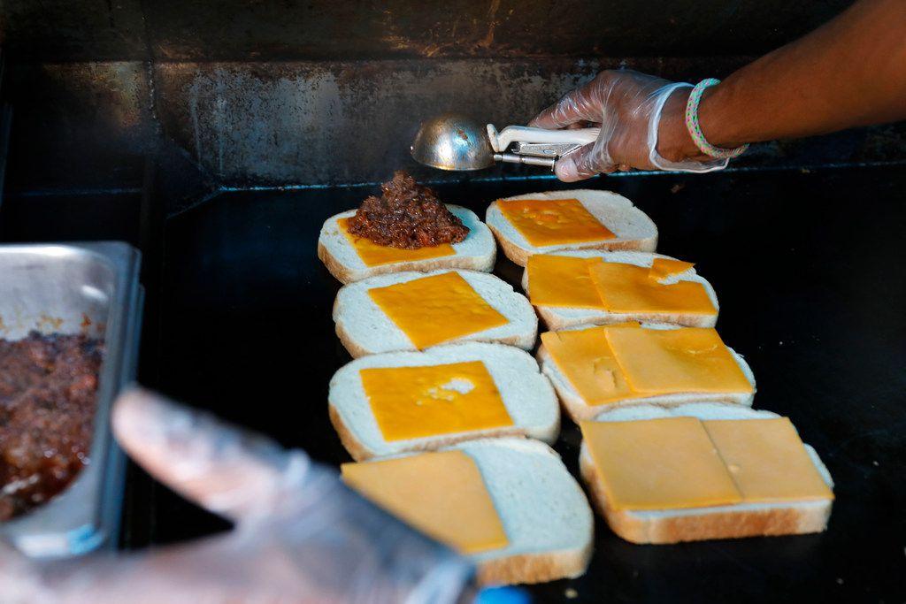 Berny Mayfield makes a grilled cheese sandwich with bbq brisket on sourdough bread in Ruthie's Rolling Cafe food truck at Klyde Warren Park on Friday, December 1, 2017 in Dallas.